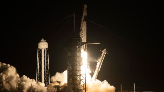 SpaceX Falcon 9 rocket with the company's Crew Dragon spacecraft onboard takes off during the Demo-1 mission at the Kennedy Space Center in Florida on March 2, 2019.
