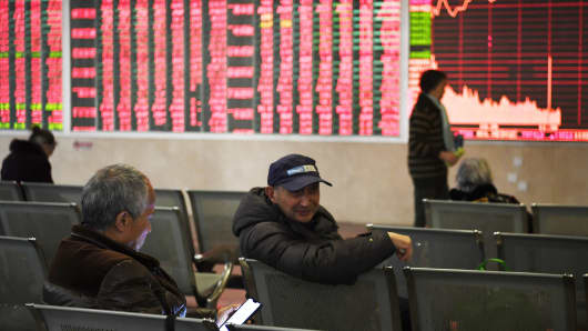 Investors watch the electronic board at a stock exchange hall on February 11, 2019 in Chengdu, Sichuan Province of China.