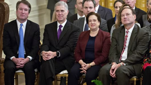 Associate Justices of the Supreme Court including Brett Kavanaugh, from left, Neil Gorsuch, Elena Kagan Samuel Alito Jr., Ruth Bader Ginsburg and Chief Justice John Roberts, listen during a Presidential Medal of Freedom ceremony in the East Room of the White House in Washington, D.C., U.S., on Friday, Nov. 16, 2018.