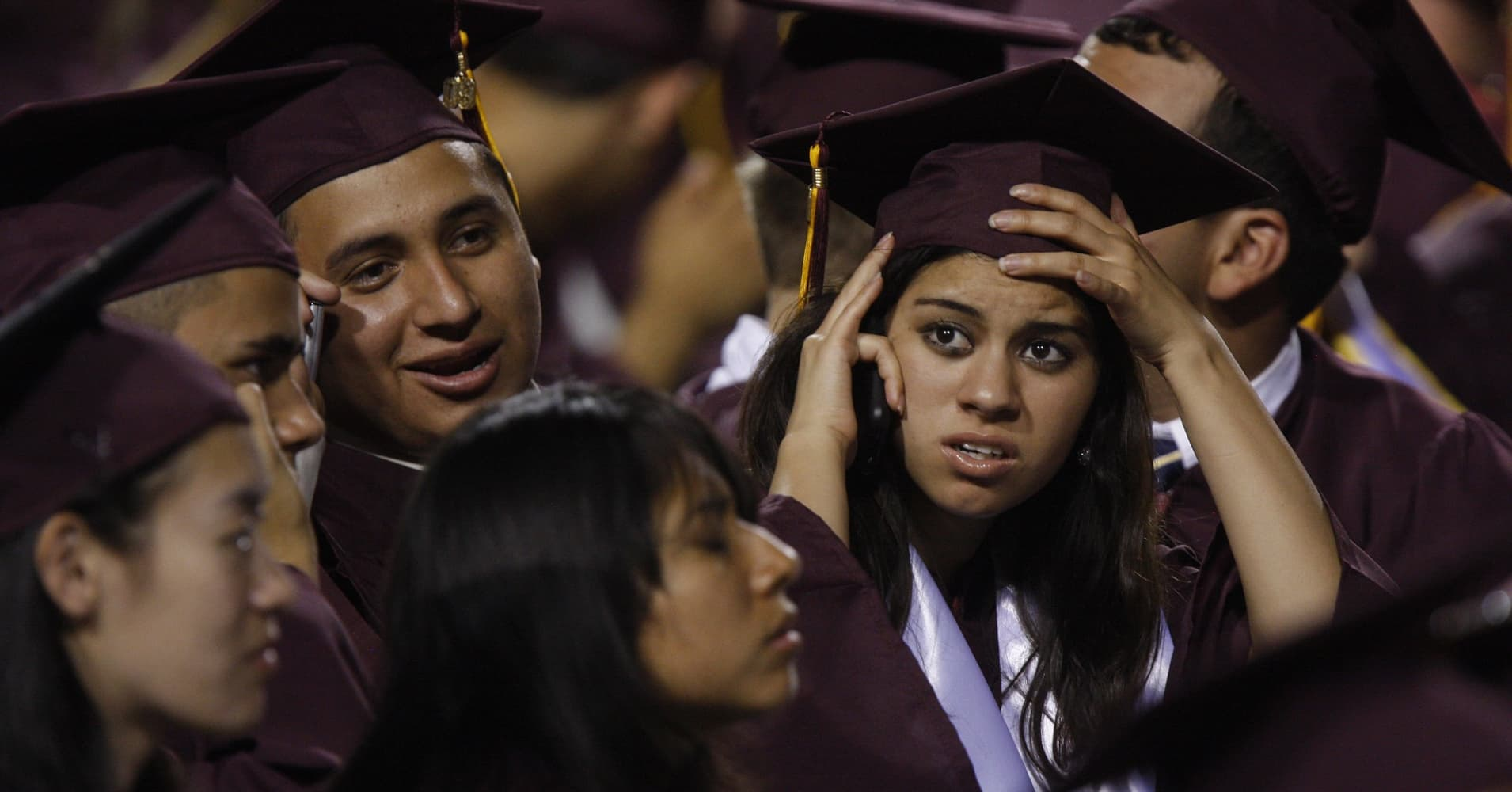 Arizona State University graduate students are seen in their seats during their graduation ceremony after US President Barack Obama delivered the commencement address at Sun Devil Stadium May 13, 2009, in Tempe, Arizona. Over 65,000 people attended the graduation.