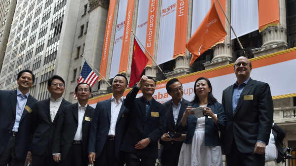 Chinese online retail giant Alibaba CEO Jack Ma (C) and his company's other executives arrive at the New York Stock Exchange in New York on September 19, 2014. Alibaba is poised for a record-breaking stock market debut on September 19, with shares priced at $68 in a public offering that could be valued at $25 billion. The company will step into the spotlight on the New York Stock Exchange, priced at the top of the $66-$68 per share range announced earlier this week, according to documents filed with US regulators. AFP PHOTO/Jewel Samad        (Photo credit should read JEWEL SAMAD/AFP/Getty Images)