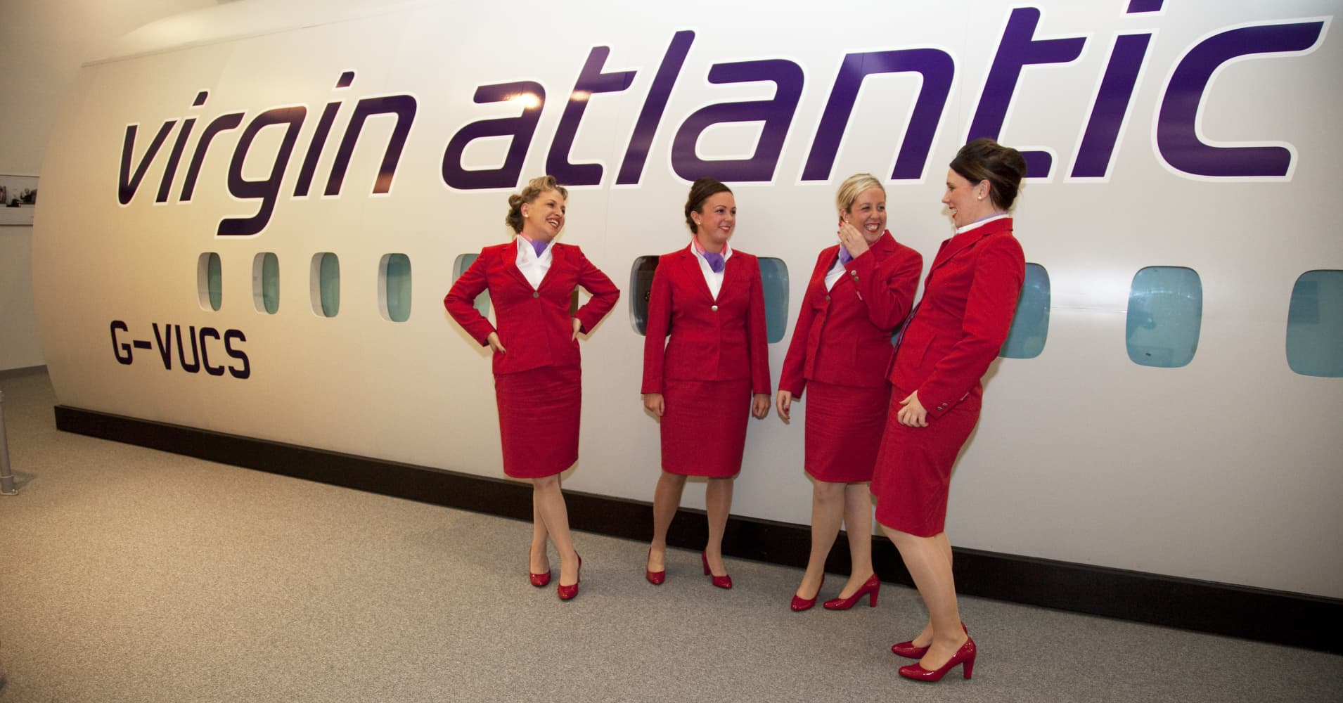 Virgin Atlantic air stewardesses training at a facility in Crawley. Potential hostesses are put through a gruelling 6 week training program, during which they are tested to their limits. With exams every day requiring an 88% score to pass.