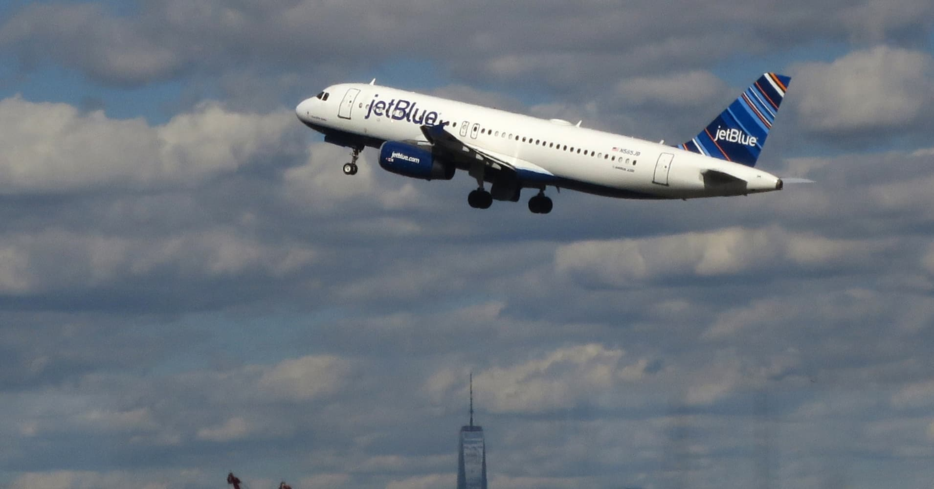 A jetBlue airplane flies over New York's Lower Manhattan as it takes off from Newark Liberty International Airport in Newark, New Jersey.