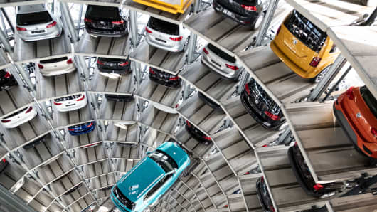 The Volkswagen T-Cross model is based on a lifting platform in a car tower on the premises of the Volkswagen factory.