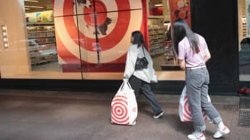 Shoppers carry away their purchases from a Target store in Chicago, Illinois.