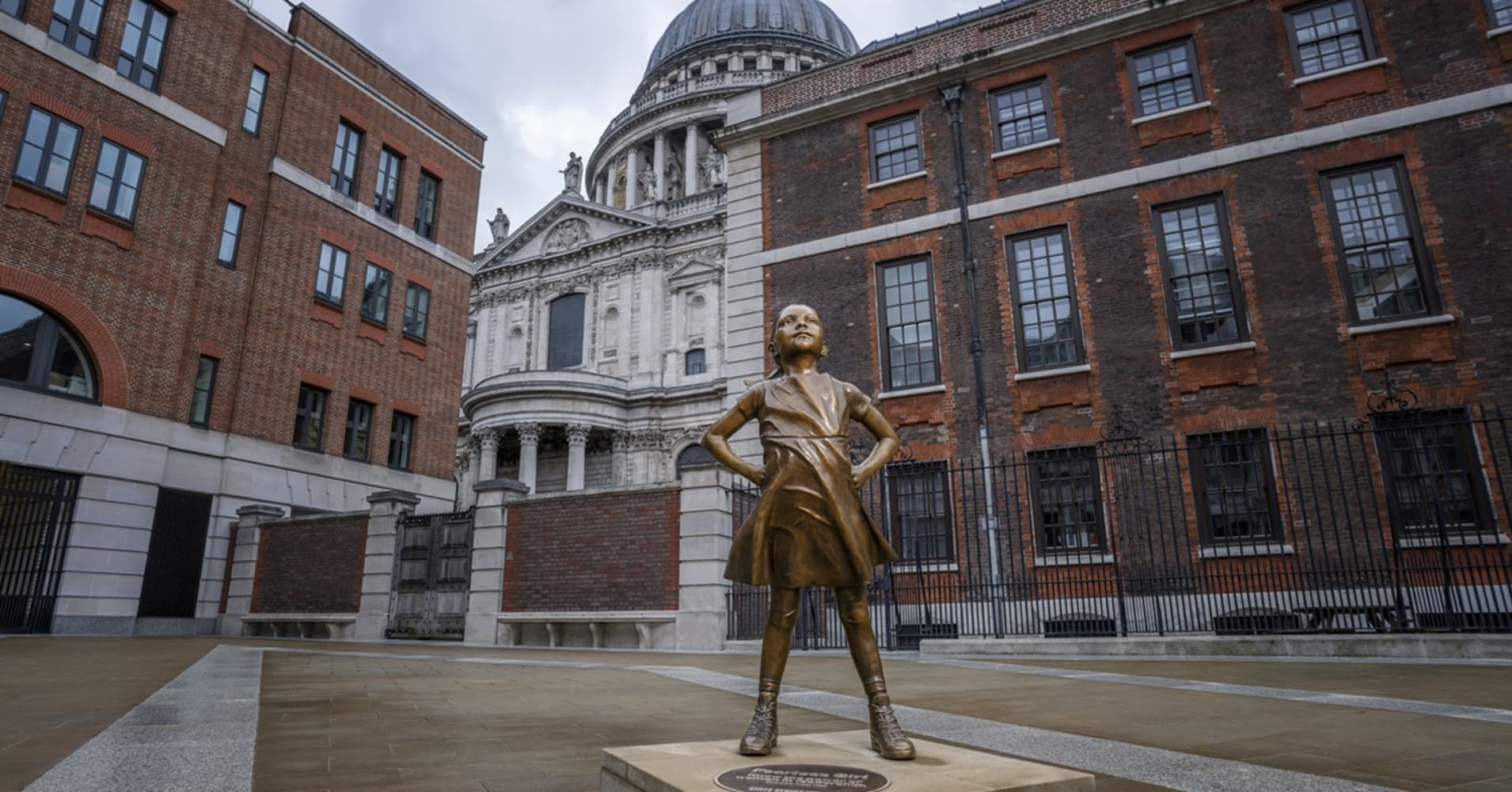 Fearless Girl statue in London. Sculpture by Kristen Visbal.