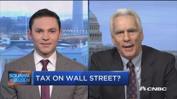Two tax experts debate the impacts of a trading tax