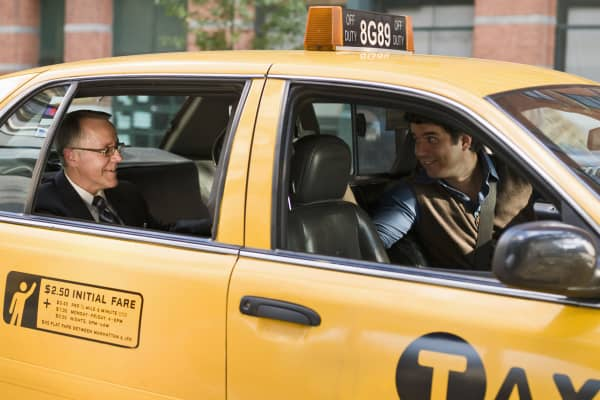 Business man talking with taxi driver
