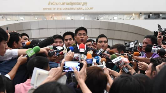 Thai Raksa Chart party leader Preechaphol Pongpanich (C) speaks to journalists after the Constitutional Court ruling to dissolve the party in Bangkok on March 7, 2019.