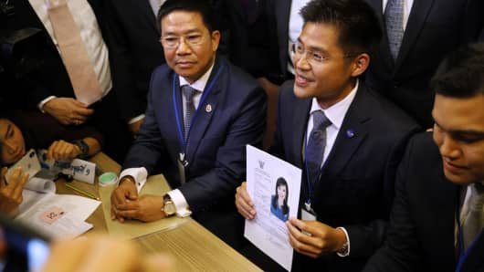 An official of Raksa Chart party holds the registration document bearing the photograph of Thai Princess Ubolratana prior to submitting to election commission officials in Bangkok on February 8, 2019.