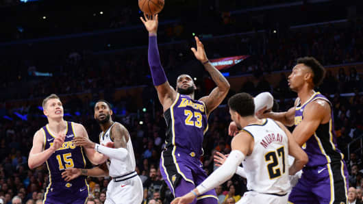 4abcbf7ec9a Los Angeles Lakers forward LeBron James (23) moves to the basket against  Denver Nuggets