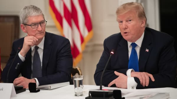 US President Donald Trump speaks alongside Apple CEO Tim Cook (L) during the first meeting of the American Workforce Policy Advisory Board in the State Dining Room of the White House in Washington, DC, March 6, 2019.