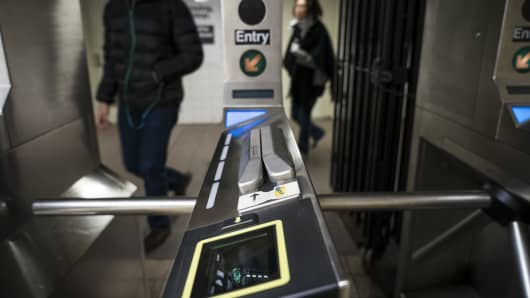 A view of a new smartphone payment reader at a turnstile entrance at the Wall Street subway station, November 10, 2017 in New York City.