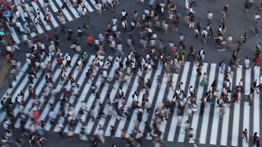 This picture taken on August 17, 2018 shows people crossing a scramble intersection in Tokyo's shopping district Shibuya. (Photo by Kazuhiro NOGI / AFP) (Photo credit should read KAZUHIRO NOGI/AFP/Getty Images)