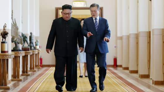 South Korean President Moon Jae-in (R) walks with North Korean leader Kim Jong Un (L) before their meeting at Paekhwawon State Guesthouse on September 19, 2018 in Pyongyang, North Korea.