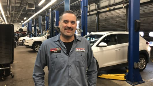 Automotive mechanics and technicians like Michael Gerhart are in high demand as a blue-collar worker shortage is expected to continue this year.
