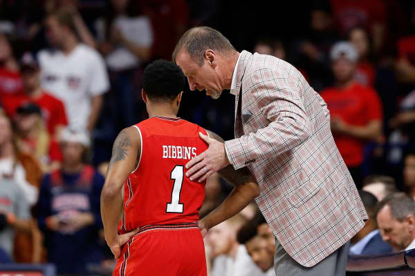 Head coach Larry Krystkowiak talks with Justin Bibbins #1 of the Utah Utes during the first half of the college basketball game against the Arizona Wildcats at McKale Center on January 27, 2018 in Tucson, Arizona.