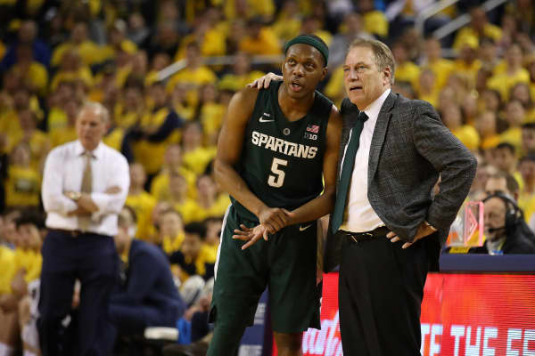 Cassius Winston #5 of the Michigan State Spartans talks with head coach Tom Izzo while playing the Michigan Wolverines at Crisler Arena on February 24, 2019 in Ann Arbor, Michigan. Michigan State won the game 77-70.