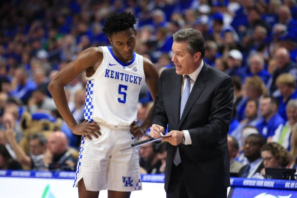 Immanuel Quickley #5 of the Kentucky Wildcats and head coach John Calipari discuss a play against the South Carolina Gamecocks at Rupp Arena on February 05, 2019 in Lexington, Kentucky.
