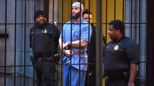 Officials escort 'Serial' podcast subject Adnan Syed from the courthouse on Feb. 3, 2016, following the completion of the first day of hearings for a retrial in Baltimore.