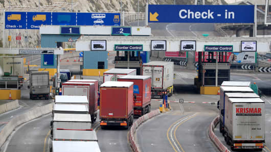 Lorries arrive at the Port of Dover in Kent, ahead of the debate and vote on the Brexit motion at the House of Commons, London.