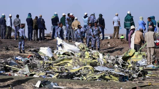 Ethiopian Federal policemen stand at the scene of the Ethiopian Airlines Flight ET 302 plane crash, near the town of Bishoftu, southeast of Addis Ababa, Ethiopia March 11, 2019.
