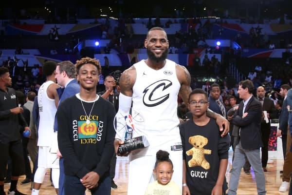 LeBron James and his family after receiving the MVP trophy for the 2018 NBA All-Star Game