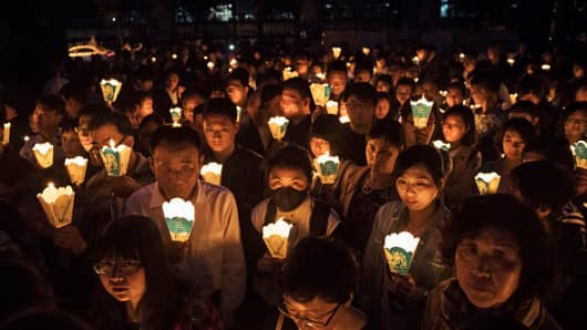 Chinese Catholics hold candles at a mass on Holy Saturday during Easter celebrations at the government sanctioned West Beijing Catholic Church on April 15, 2017 in Beijing, China.