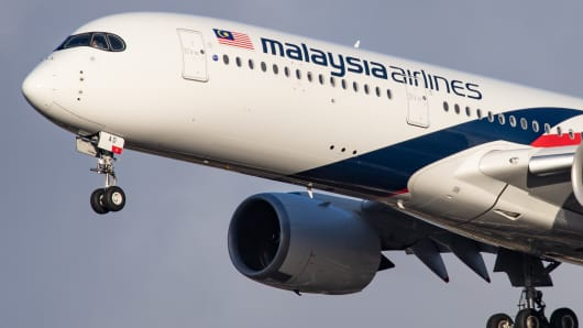 Malaysia Airlines Airbus A350-900 aircraft with registration 9M-MAD landing at London Heathrow International Airport LHR EGLL.