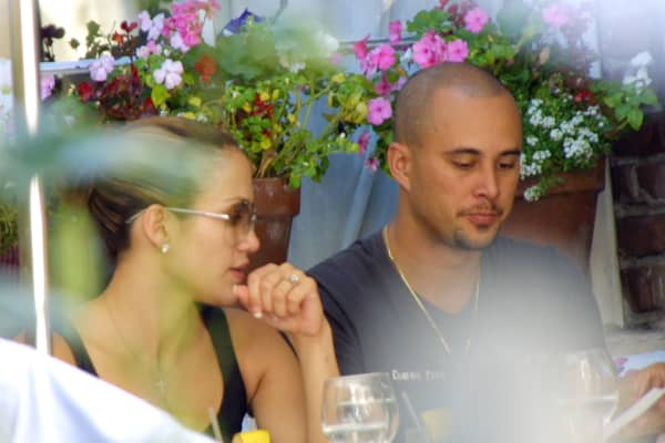 Jennifer Lopez and her fiance dancer Cris Judd share a moment Sept. 27, 2001 at The Ivy restaurant in Los Angeles.