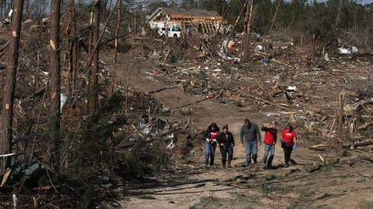 Volunteers help after a tornado touchdown on March 6, 2019, in Beauregard, Alabama.