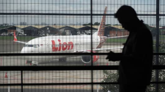 A Batik Air Boeing Co. 737 Max 8 aircraft, operated by Lion Air, center, sits on the tarmac at Soekarno-Hatta International Airport in Cenkareng, Indonesia, on Tuesday, March 12, 2019.