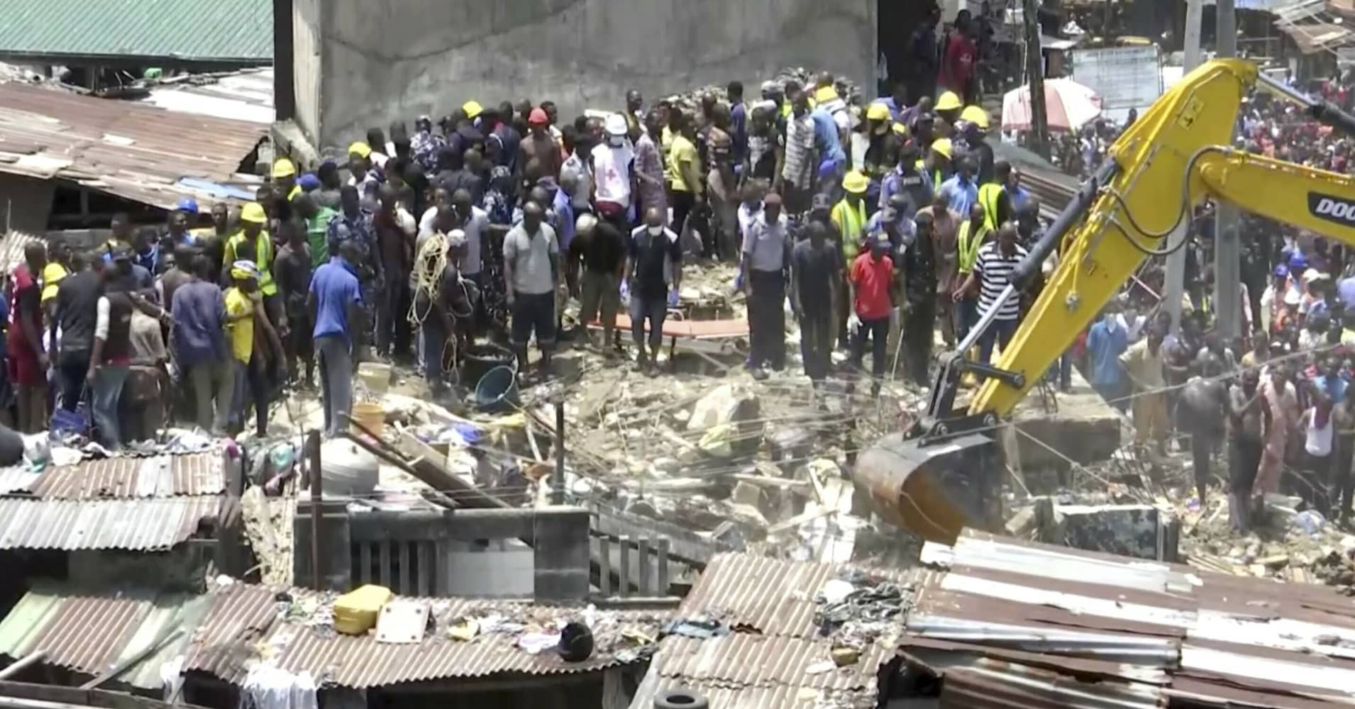 100 children, many others feared trapped in collapse of Nigeria building that housed school