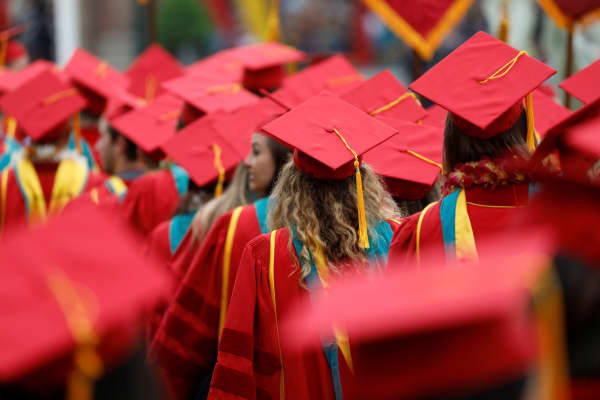 Graduates walk before the commencement ceremony at the University of Southern California (USC) in Los Angeles, California, U.S., May 12, 2017