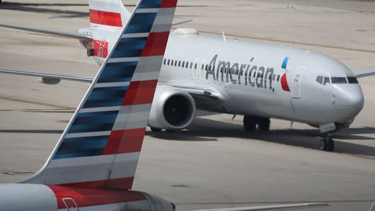 An American Airlines Boeing 737 Max 8 arriving from Washington's Ronald Reagan National Airport is seen taxiing to its gate at the Miami International Airport on March 12, 2019 in Miami, Florida.