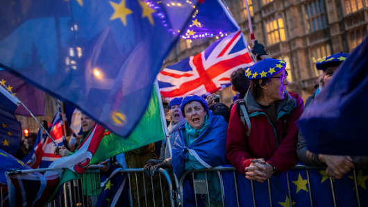 Pro-Brexit protesters demonstrate outside the Houses of Parliament on March 13, 2019 in London, England.