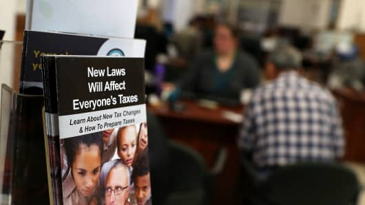 A pamphlet about the new tax laws is displayed at Liberty Tax Service tax in Oakland, California.