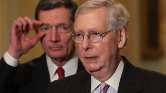 U.S. Senate Majority Leader Sen. Mitch McConnell (R-KY) (R) speaks as Sen. John Barrasso (R-WY) (L) looks on during a news briefing after the weekly Senate Republican policy luncheon March 12, 2019 at the U.S.