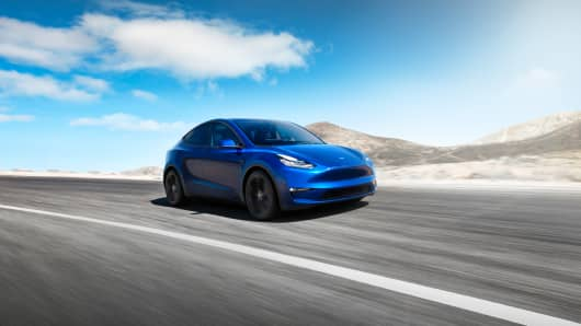 Tesla's Model Y is a crossover SUV that seats seven, features a panoramic glass roof and 66 cubic feet of cargo space.