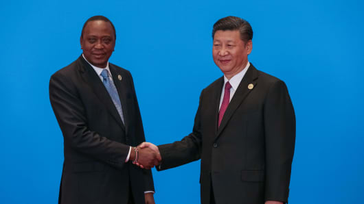 BEIJING, CHINA - MAY 15: Chinese President Xi Jinping (R) shakes hands with Kenyan President Uhuru Kenyatta as they attend the welcome ceremony at Yanqi Lake during the Belt and Road Forum May 15, 2017 in Beijing, China.