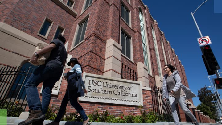 A view of people visiting the University of Southern California on March 12, 2019 in Los Angeles, California. Federal prosecutors say their investigation dubbed Operation Varsity Blues blows the lid off an audacious college admissions fraud scheme aimed at getting the children of the rich and powerful into elite universities.