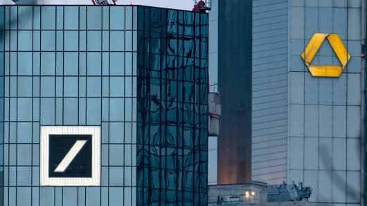 A picture taken on 17 March 2019 shows the headquarters of the German banks Deutsche Bank (L) and Commerzbank in Frankfurt am Main, West Germany