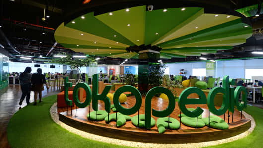 The PT Tokopedia logo is displayed at the company's offices in Jakarta, Indonesia, on Friday, Feb. 19, 2016. Photographer: Dimas Ardian/Bloomberg via Getty Images