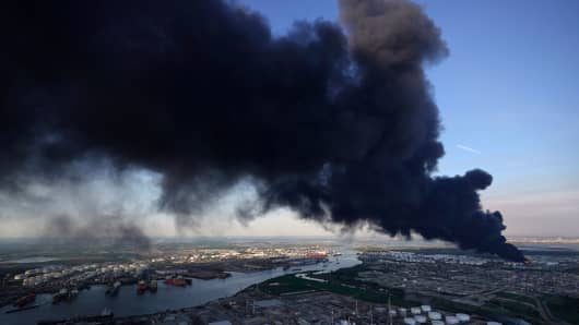 A plume of smoke rises from a petrochemical fire at the Intercontinental Terminals Company, Monday, March 18, 2019, in Deer Park, Texas.