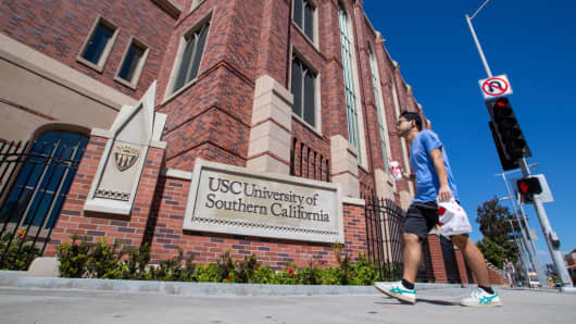 A view of people visiting the University of Southern California on March 12, 2019 in Los Angeles, California. Federal prosecutors say their investigation dubbed Operation Varsity Blues blows the lid off an audacious college admissions fraud scheme aimed at getting the children of the rich and powerful into elite universities. A