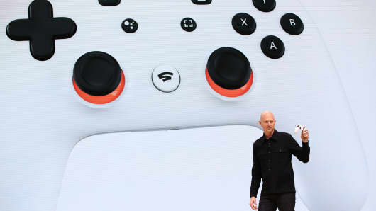 Google vice president and general manager Phil Harrison shows the new Stadia controller as he speaks during the GDC Game Developers Conference on March 19, 2019 in San Francisco, California.