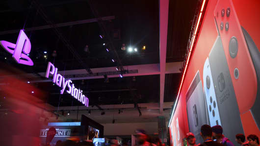 Sony Corp. PlayStation and Nintendo Co. Switch game console signage is displayed during the E3 Electronic Entertainment Expo in Los Angeles, California, U.S., on Wednesday, June 14, 2017.