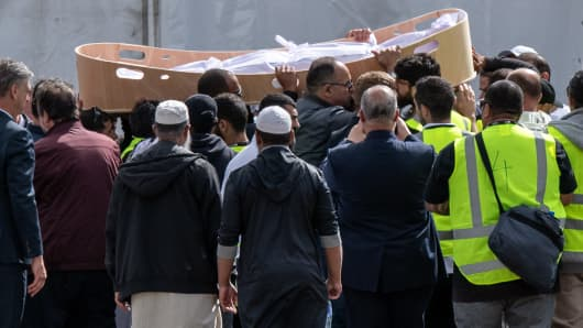 A coffin containing the body of a victim of the Christchurch terrorist attack is carried for burial at Memorial Park Cemetery on March 20, 2019 in Christchurch, New Zealand. 50 people were killed, and dozens are still injured in hospital after a gunman opened fire on two Christchurch mosques on Friday, 15 March.