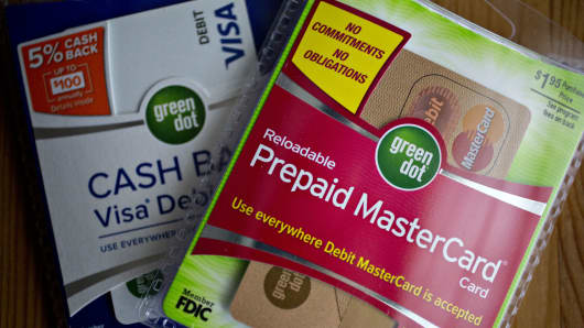 Packages containing a Green Dot Corp. prepaid Mastercard Inc. debit card and Visa Inc. debit card, left, are arranged for a photograph in Washington, D.C., U.S., on Thursday, Feb. 15, 2018.