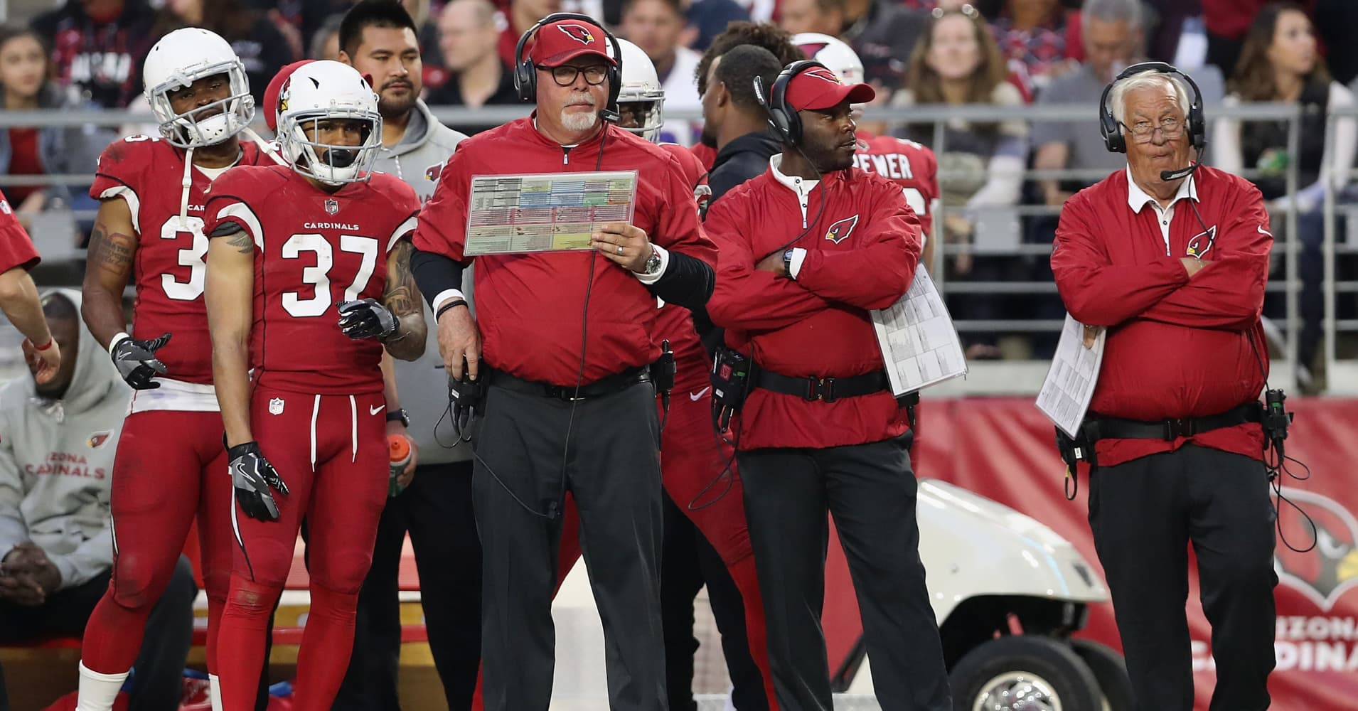 Head coach Bruce Arians (C) of the Arizona Cardinals watches from the sidelines during the second half of the NFL game against the New York Giants at the University of Phoenix Stadium.